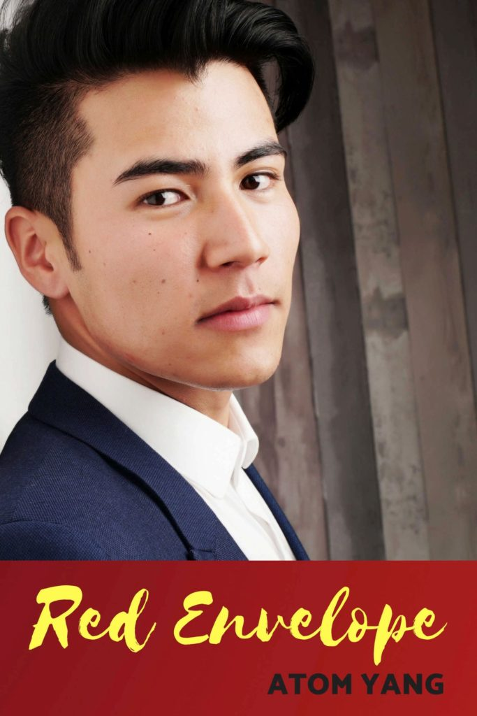 Cover of Red Envelope depicting a young, handsome Asian man in a suit, leaning against a wall and gazing toward to the viewer.